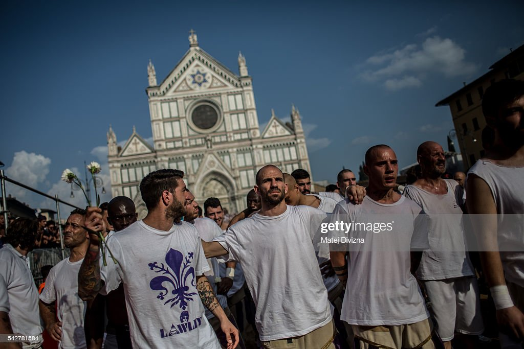 Players of the Santo Spirito Bianchi Team arrive for the final match of The Calcio Storico Fiorentino between the Santo Spirito Bianchi (White) Team and the La Santa Croce Azzuri (Blue) Team at the La Santa Croce square on June 24, 2016 in Florence, Italy. The Calcio Storico (Historical Football in English) Fiorentino is an early form of football, originating in the 1500's. It is a combination of football, rugby and wrestling. Now, annually during a weekend in early June, four teams representing the districts of Florence face each other in the first semi-finals. The winners go to the final, played every year on June 24, the day of the patron of Florence, St. John the Baptist. The official rules of calcio (football) were written for the first time in 1580 by Giovanni de Bardi, a count from Florence. The teams are formed by 27 players and the ball can be played either with hands or feet. Tactics such as punching, elbowing and all martial arts techniques are allowed but kicks to the are forbidden, as are fights of two or more against one. There is a referee, a field master, and six linesmen. The game lasts 50 minutes, and the winning team is the one who scores most points. The playing field is a giant sand pit with a narrow split constructing the goal running the width of each end. The Calcio Storico was not played for 200 years, until its revival in 1930.
