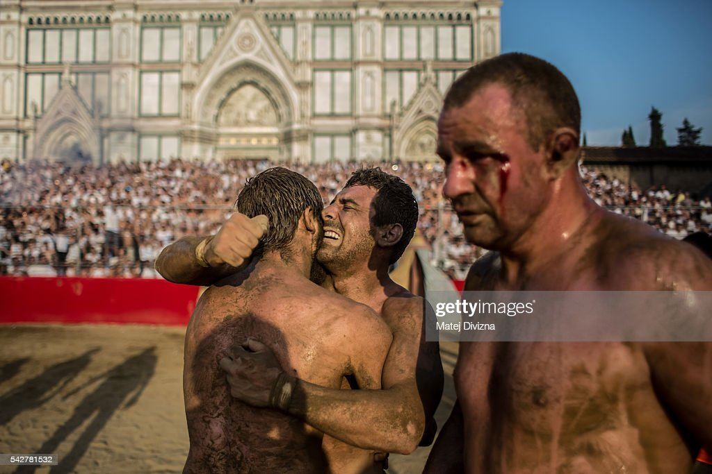 Players of the Santo Spirito Bianchi Team celebrate after defeating the La Santa Croce Azzuri Team during the final match of The Calcio Storico Fiorentino at the La Santa Croce square on June 24, 2016 in Florence, Italy. The Calcio Storico (Historical Football in English) Fiorentino is an early form of football, originating in the 1500's. It is a combination of football, rugby and wrestling. Now, annually during a weekend in early June, four teams representing the districts of Florence face each other in the first semi-finals. The winners go to the final, played every year on June 24, the day of the patron of Florence, St. John the Baptist. The official rules of calcio (football) were written for the first time in 1580 by Giovanni de Bardi, a count from Florence. The teams are formed by 27 players and the ball can be played either with hands or feet. Tactics such as punching, elbowing and all martial arts techniques are allowed but kicks to the are forbidden, as are fights of two or more against one. There is a referee, a field master, and six linesmen. The game lasts 50 minutes, and the winning team is the one who scores most points. The playing field is a giant sand pit with a narrow split constructing the goal running the width of each end. The Calcio Storico was not played for 200 years, until its revival in 1930.