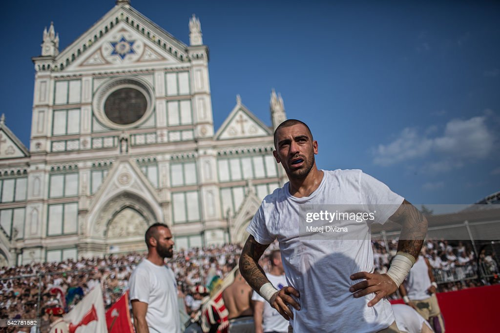 Players of the Santo Spirito Bianchi Team prepare before the final match of The Calcio Storico Fiorentino between the Santo Spirito Bianchi (White) Team and the La Santa Croce Azzuri (Blue) Team at the La Santa Croce square on June 24, 2016 in Florence, Italy. The Calcio Storico (Historical Football in English) Fiorentino is an early form of football, originating in the 1500's. It is a combination of football, rugby and wrestling. Now, annually during a weekend in early June, four teams representing the districts of Florence face each other in the first semi-finals. The winners go to the final, played every year on June 24, the day of the patron of Florence, St. John the Baptist. The official rules of calcio (football) were written for the first time in 1580 by Giovanni de Bardi, a count from Florence. The teams are formed by 27 players and the ball can be played either with hands or feet. Tactics such as punching, elbowing and all martial arts techniques are allowed but kicks to the are forbidden, as are fights of two or more against one. There is a referee, a field master, and six linesmen. The game lasts 50 minutes, and the winning team is the one who scores most points. The playing field is a giant sand pit with a narrow split constructing the goal running the width of each end. The Calcio Storico was not played for 200 years, until its revival in 1930.