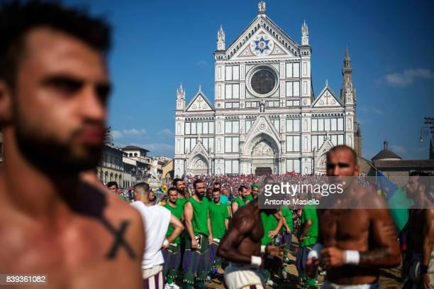 Players of the Santo Spirito Bianchi team walk into the La Santa Croce square during the final match of 'Calcio Storico Fiorentino' on June 24 2017