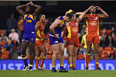 Players of the Suns and the Eagles look dejected during the round 18 AFL match between the Gold Coast Suns and the West Coast Eagles at Metricon...