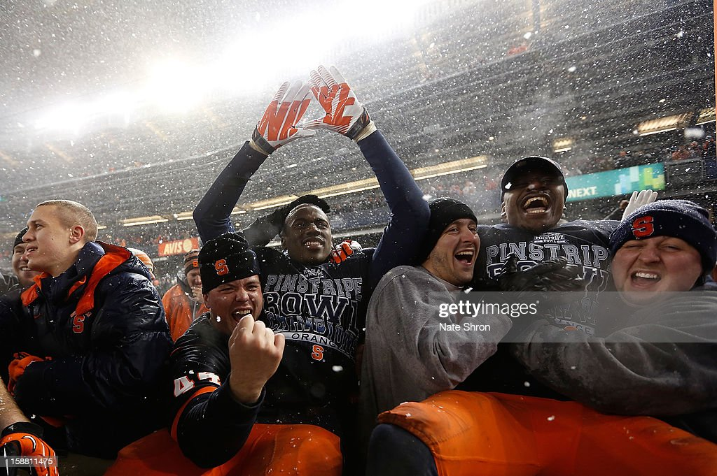 Players of the Syracuse Orange celebrate with fans after the win over the West Virginia Mountaineers during the New Era Pinstripe Bowl at Yankee Stadium on December 29, 2012 in the Bronx borough of New York City.