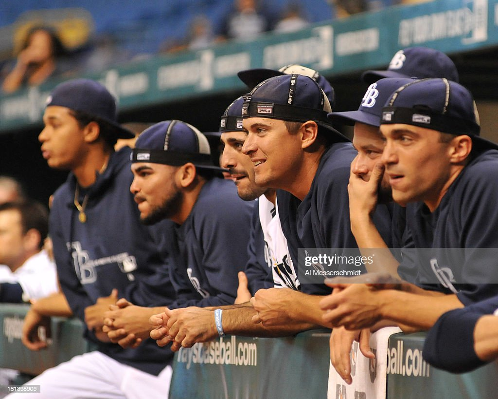 Players of the Tampa Bay Rays turn their caps inside out as the game enters the 17th inning against the Baltimore Orioles September 20, 2013 at Tropicana Field in St. Petersburg, Florida. The Rays won 5 - 4 in 18 innings.