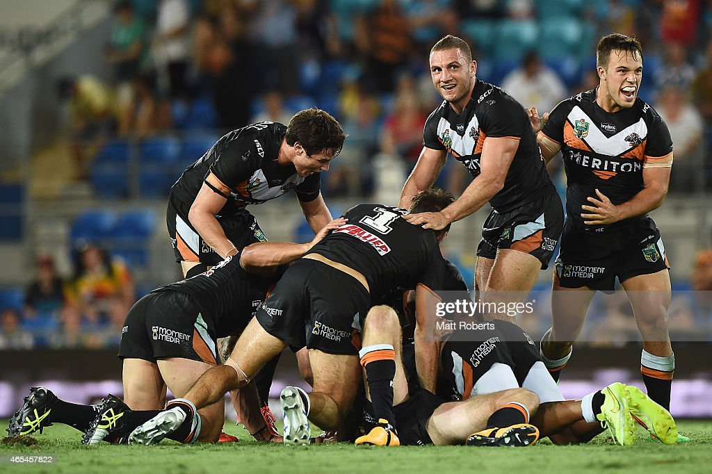 Players of the Tigers celebrate victory after a field goal by Pat Richards of the Tigers during the round one NRL match between the Gold Coast Titans and the Wests Tigers at Cbus Super Stadium on March 7, 2015 on the Gold Coast, Australia.