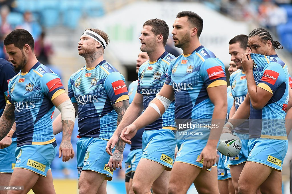 Players of the Titans leave the field after warm up during the round 16 NRL match between the Gold Coast Titans and the Canberra Raiders at Cbus Super Stadium on June 26, 2016 in Gold Coast, Australia.