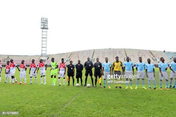 Players of the Union Sportive Seme Krake and players of the Roquins de l'Atlantique line up prior to a match at the Mathieu Kerekou stadium in...