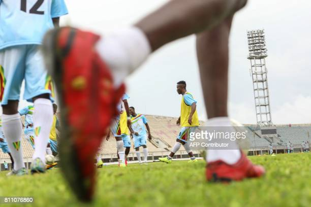 Players of the Union Sportive Seme Krake warm up at the Mathieu Kerekou stadium in Cotonou on July 8 2017 Topflight football resumed in tiny west...