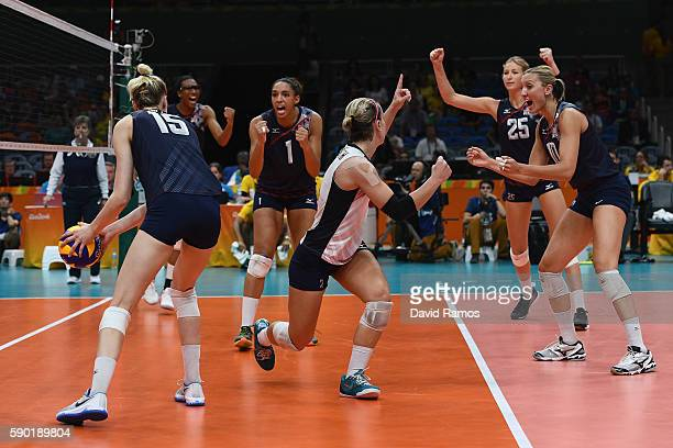 Players of The United States celebrate defeating Japan during the Women's Quarterfinal match between Japan and The United States on day 11 of the Rio...