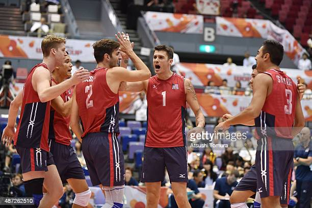 Players of the USA celebrate after a point in the match between USA and Australia during the FIVB Men's Volleyball World Cup Japan 2015 at the...