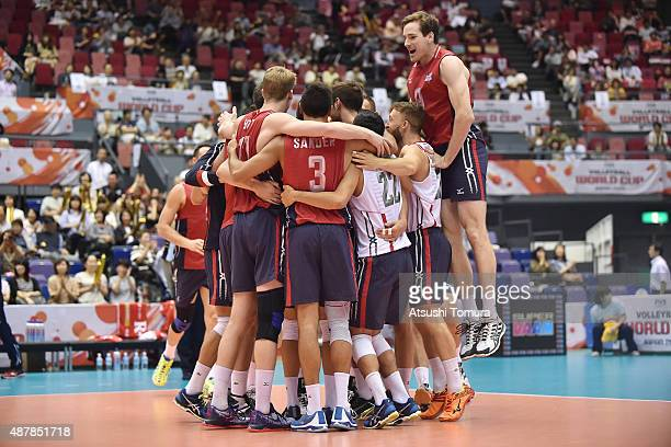 Players of the USA celebrates after winning the match against Italy during the FIVB Men's Volleyball World Cup Japan 2015 at the Hiroshima Green...