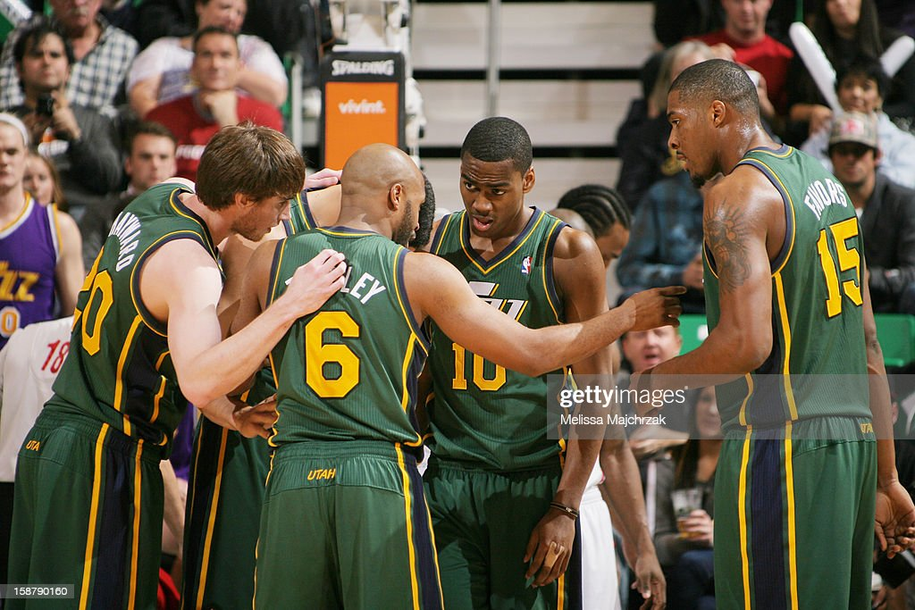 Players of the Utah Jazz huddle on court during a break in play against the Los Angeles Clippers at Energy Solutions Arena on December 28, 2012 in Salt Lake City, Utah.