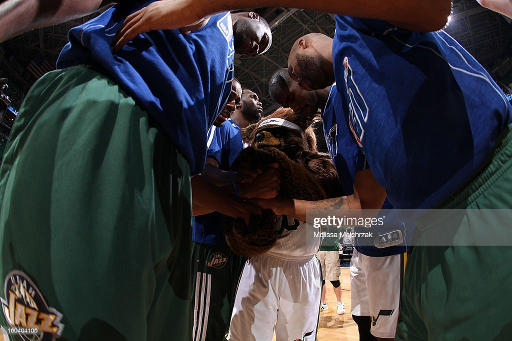 Players of the Utah Jazz huddle with Jazz Bear before their matchup against the New Orleans Hornets at Energy Solutions Arena on January 30, 2013 in Salt Lake City, Utah.