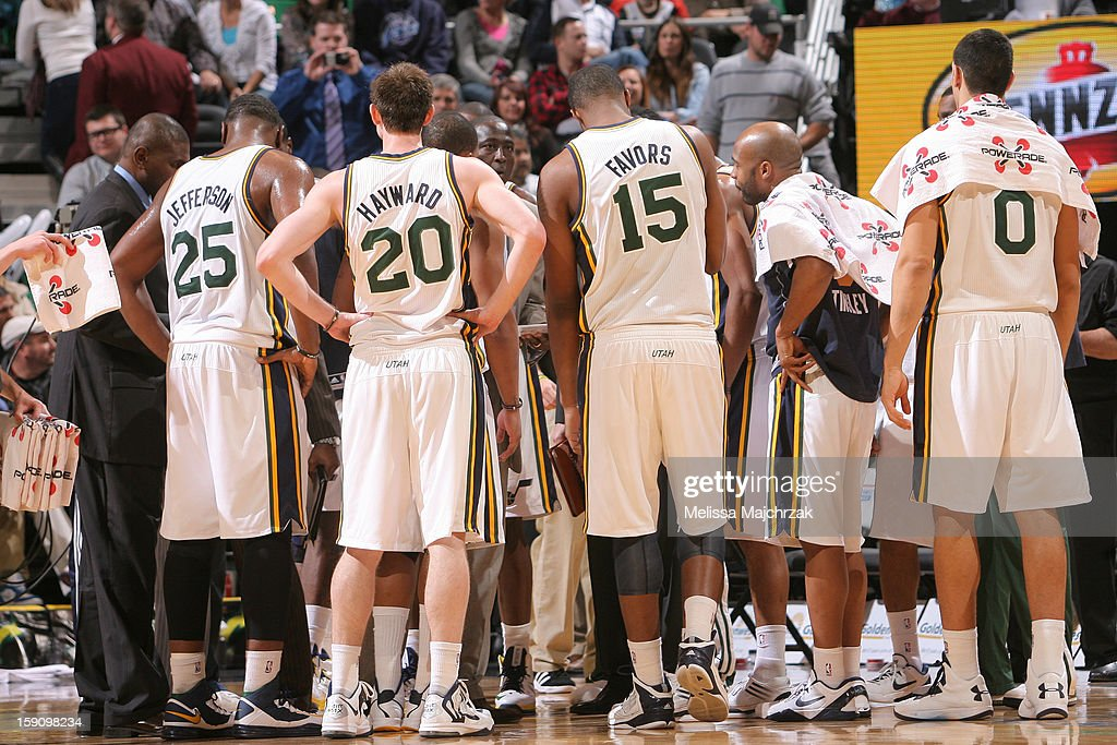 Players of the Utah Jazz meet during a timeout against the Dallas Mavericks at Energy Solutions Arena on January 7, 2013 in Salt Lake City, Utah.