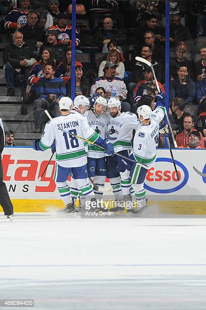 Players of the Vancouver Canucks celebrate after a goal during the game against the Edmonton Oilers on November 19 2014 at Rexall Place in Edmonton...
