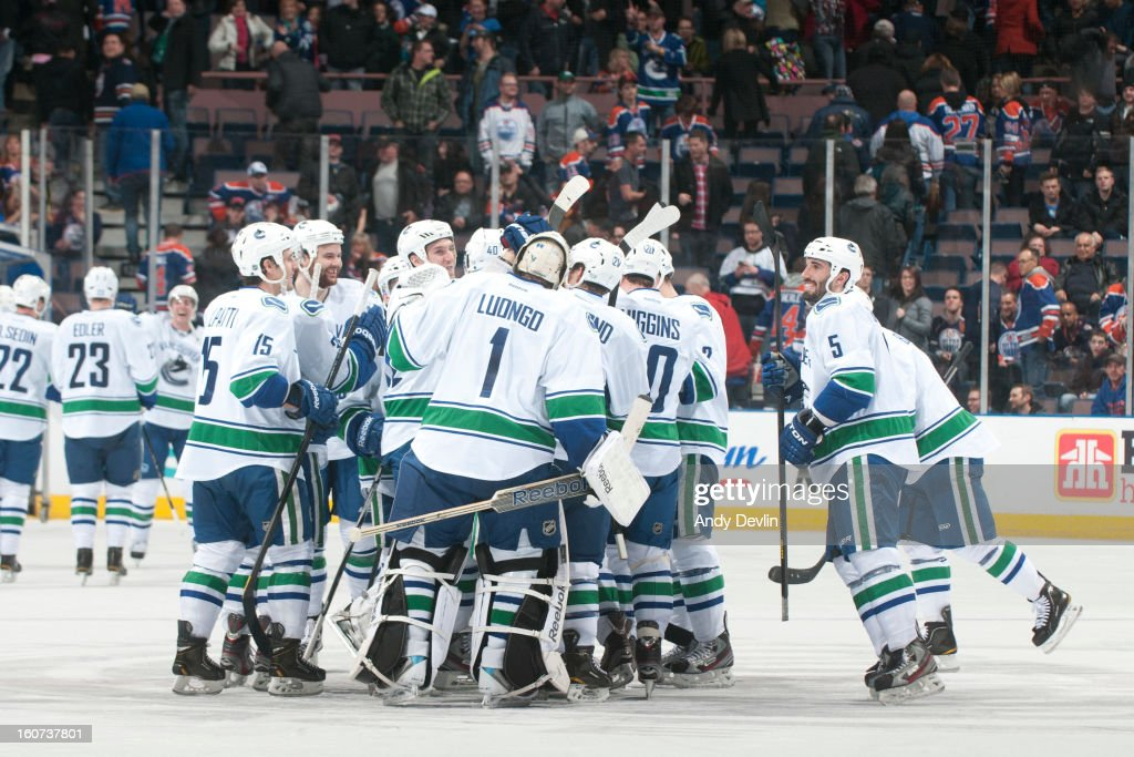 Players of the Vancouver Canucks celebrate after winning a game against the Edmonton Oilers on February 4, 2013 at Rexall Place in Edmonton, Alberta, Canada.
