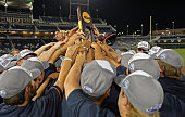Players of the Virginia Cavaliers hold up the National Championship trophy after defeating the Vanderbilt Commodores during game three of the College...