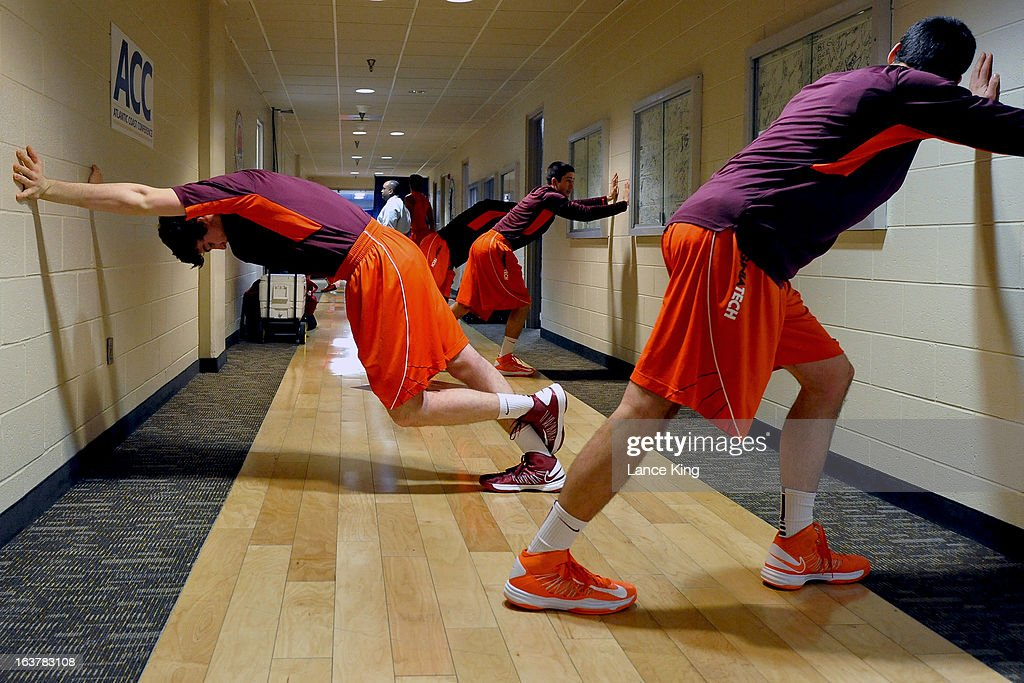 Players of the Virginia Tech Hokies stretch in a hallway prior to their game against the North Carolina State Wolfpack during the first round of the 2013 Men's ACC Tournament at the Greensboro Coliseum on March 14, 2013 in Greensboro, North Carolina. NC State defeated Virginia Tech 80-63.