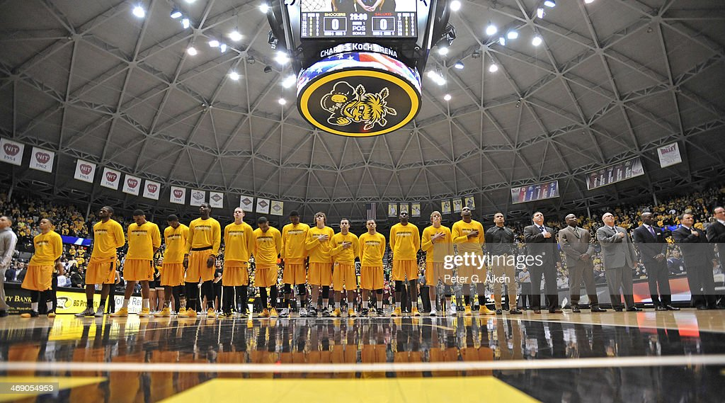 Players of the Wichita State Shockers stand at attention during the National Anthem before a game against the Southern Illinois Salukis during on February 11, 2014 at Charles Koch Arena in Wichita, Kansas.