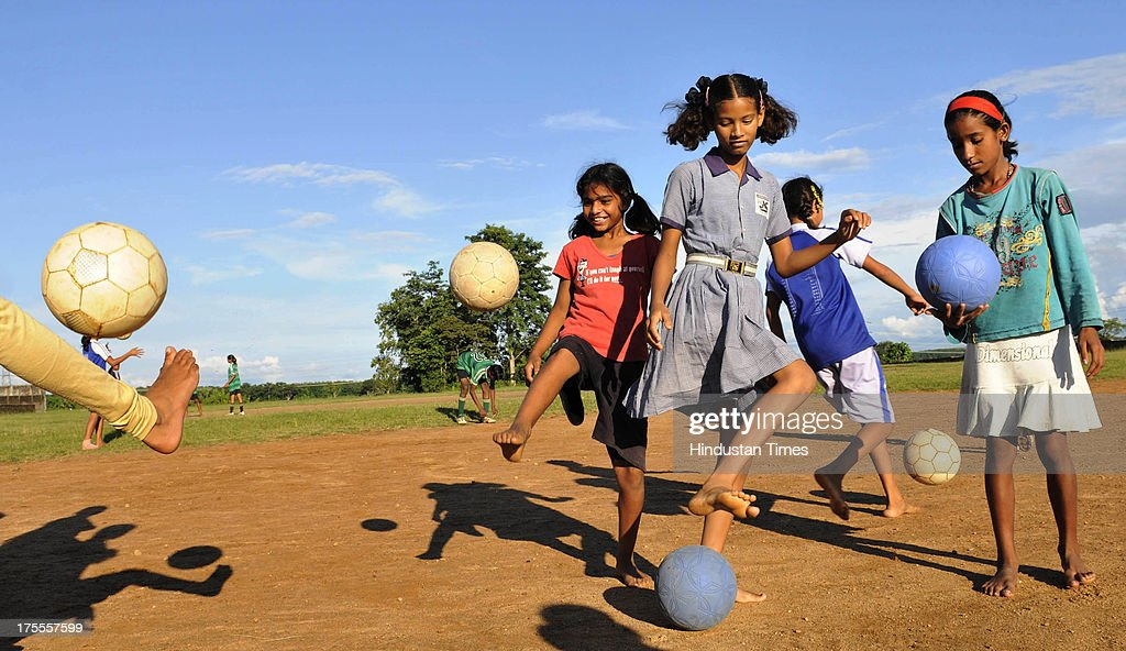 Players of the Yuwa Football Academy during the practice session at Hutap village on August 2, 2013 in Ranchi, India. On July 13, the 18 tribal girls representing Yuwa India under-14 all-girls team were placed third among 10 teams playing for the Gasteiz Cup in Victoria Gasteiz in Spain. In 2012, Yuwa became the first organisation in India to win the Nike Gamechangers Award. Yuwa also won the NDTV Spirit of Sports Award, Times Now Amazing Indians Award. Set up in 2009 by Franz Gastler, its an NGO that uses football to combat child marriage and human trafficking in Jharkhands tribal belt. Gastler, a US citizen, started as an English teacher for underprivileged children when he was requested by the girls to teach them football. He formed Yuwa India, a U-14 side with girls from local villages. Having started with 15 girls in 2009, Yuwa now has over 200 aspiring footballers. The Jharkhand government has announced it would build a stateof-the-art stadium on five acres of land for the Yuwa girls. Chief Minister Hemant Soren also announced cash awards of Rs 21,000 to each of the 18 girls who were in the squad. The Yuwa team would be felicitated by the state government on August 29, the National Sports Day.