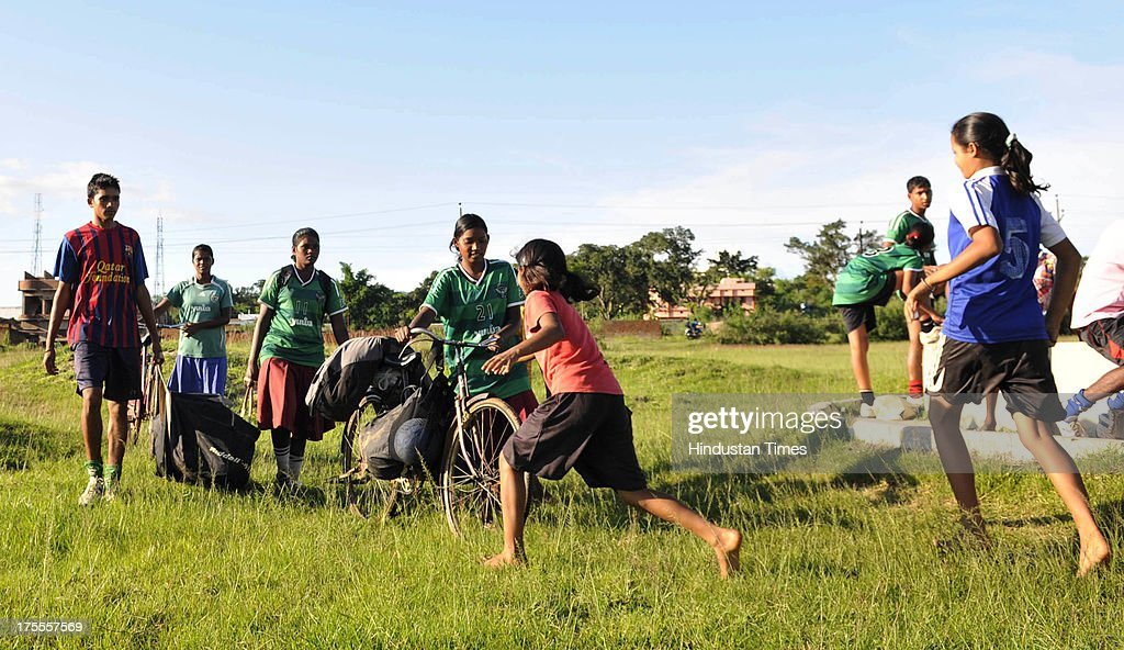 Players of the Yuwa Football Academy rushes to collect the soccar ball carried by their friends from far during the practice session at Hutap village on August 2, 2013 in Ranchi, India. On July 13, the 18 tribal girls representing Yuwa India under-14 all-girls team were placed third among 10 teams playing for the Gasteiz Cup in Victoria Gasteiz in Spain. In 2012, Yuwa became the first organisation in India to win the Nike Gamechangers Award. Yuwa also won the NDTV Spirit of Sports Award, Times Now Amazing Indians Award. Set up in 2009 by Franz Gastler, its an NGO that uses football to combat child marriage and human trafficking in Jharkhands tribal belt. Gastler, a US citizen, started as an English teacher for underprivileged children when he was requested by the girls to teach them football. He formed Yuwa India, a U-14 side with girls from local villages. Having started with 15 girls in 2009, Yuwa now has over 200 aspiring footballers. The Jharkhand government has announced it would build a stateof-the-art stadium on five acres of land for the Yuwa girls. Chief Minister Hemant Soren also announced cash awards of Rs 21,000 to each of the 18 girls who were in the squad. The Yuwa team would be felicitated by the state government on August 29, the National Sports Day.