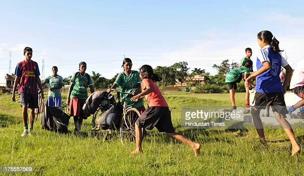 Players of the Yuwa Football Academy rushes to collect the soccar ball carried by their friends from far during the practice session at Hutap village...