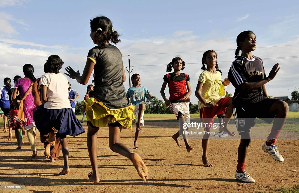 Players of the Yuwa Football Academy warm ups during the practice session at Hutap village on August 2, 2013 in Ranchi, India. On July 13, the 18 tribal girls representing Yuwa India under-14 all-girls team were placed third among 10 teams playing for the Gasteiz Cup in Victoria Gasteiz in Spain. In 2012, Yuwa became the first organisation in India to win the Nike Gamechangers Award. Yuwa also won the NDTV Spirit of Sports Award, Times Now Amazing Indians Award. Set up in 2009 by Franz Gastler, its an NGO that uses football to combat child marriage and human trafficking in Jharkhands tribal belt. Gastler, a US citizen, started as an English teacher for underprivileged children when he was requested by the girls to teach them football. He formed Yuwa India, a U-14 side with girls from local villages. Having started with 15 girls in 2009, Yuwa now has over 200 aspiring footballers. The Jharkhand government has announced it would build a stateof-the-art stadium on five acres of land for the Yuwa girls. Chief Minister Hemant Soren also announced cash awards of Rs 21,000 to each of the 18 girls who were in the squad. The Yuwa team would be felicitated by the state government on August 29, the National Sports Day.