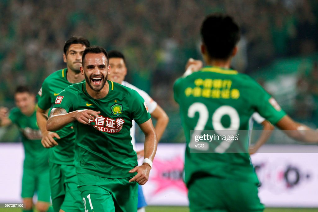 Players of Tianjin Teda celebrate a point during the 13th round match of 2017 Chinese Football Association Super League (CSL) between Beijing Guoan and Tianjin Teda at Beijing Workers' Stadium on June 18, 2017 in Beijing, China.