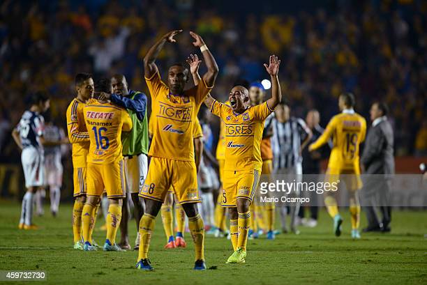 Players of Tigres celebrate after winning a quarterfinal second leg match between Tigres UANL and Pachuca as part of the Apertura 2014 Liga MX at...