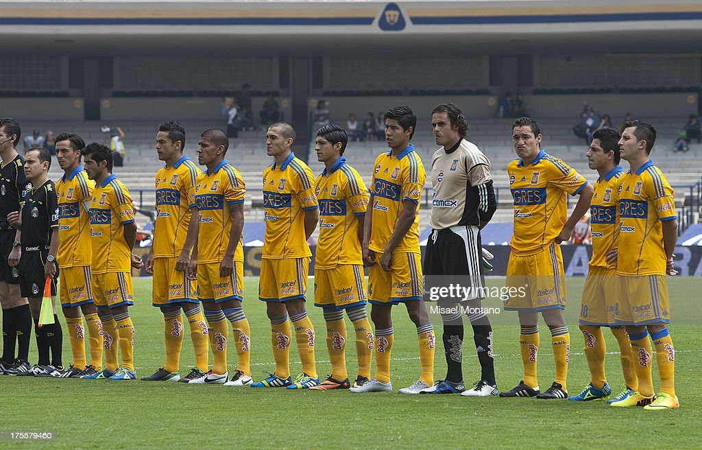 Players of Tigres line up prior to a match between Pumas and Tigres as part of Torneo Apertura of Liga MX 2013 ar Olympic Stadium on August 04, 2013 in Mexico City, Mexico.
