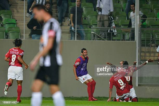 Players of Tijuana celebrate a goal during a match between Atletico Mineiro and Xolos de Tijuana as part of the Copa Bridgestone Libertadores 2013 at...