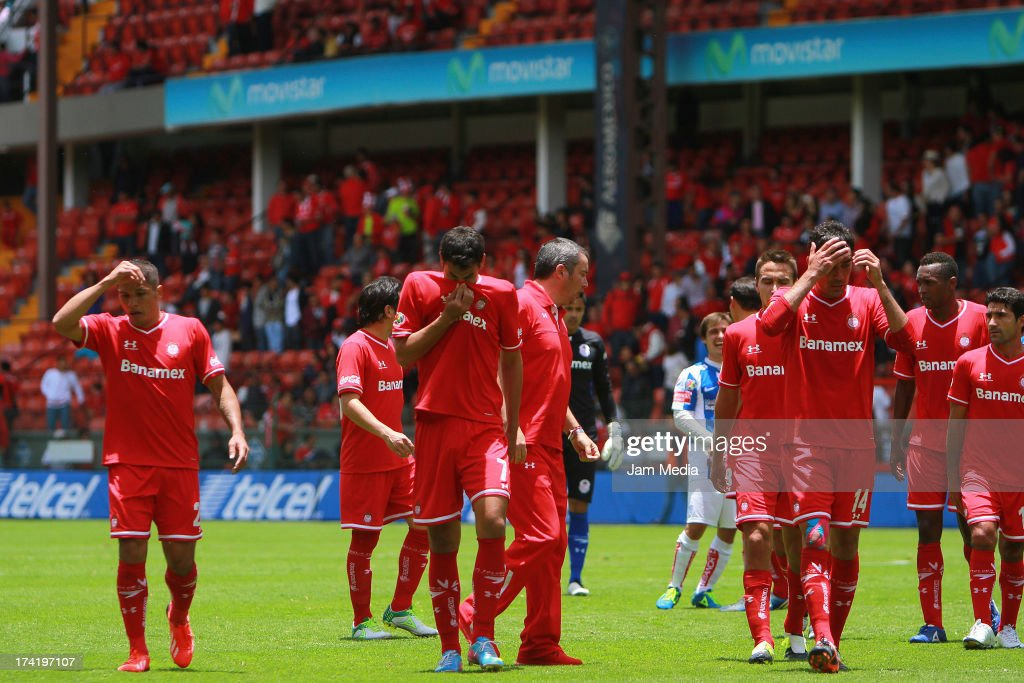 Players of Toluca react during the match between Toluca and Pachuca as part of the Apertura 2013 Liga Bancomer MX at Nemesio Diez Stadium on july 21, 2013 in Toluca, Mexico.