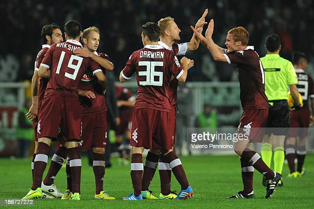 Players of Torino FC celebrate the draw at the end of the Serie A match between Torino FC and AS Roma at Stadio Olimpico di Torino on November 3 2013...