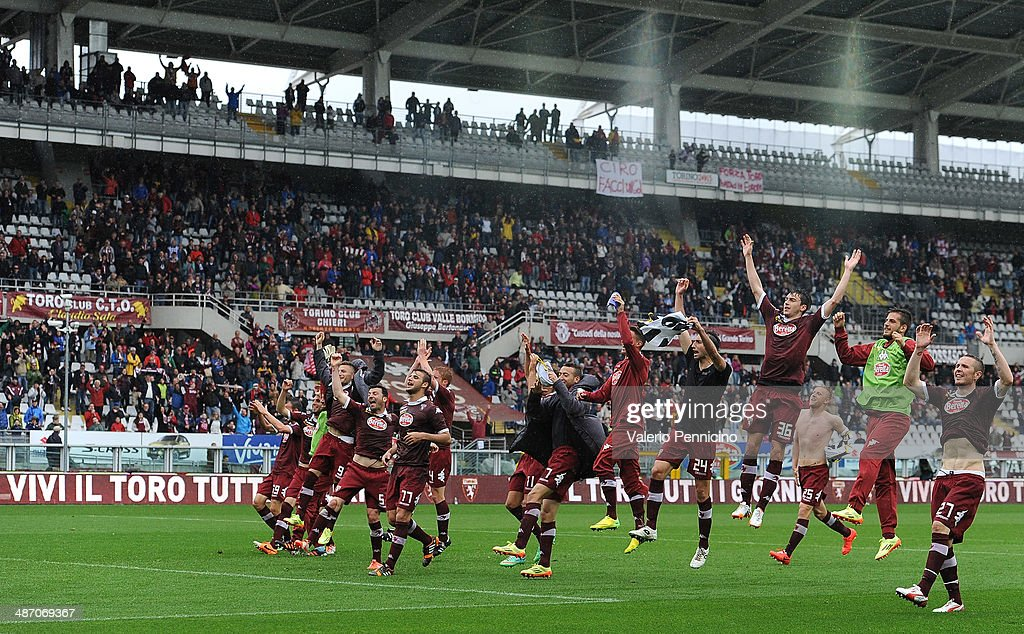 Players of Torino FC celebrate victory at the end of the Serie A match between Torino FC and Udinese Calcio at Stadio Olimpico di Torino on April 27, 2014 in Turin, Italy.