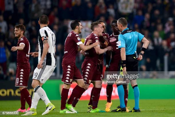 Players of Torino FC complaint with the referee Paolo Valeri after the expulsion of Afriyie Acquah during the Serie A football match between Juventus...