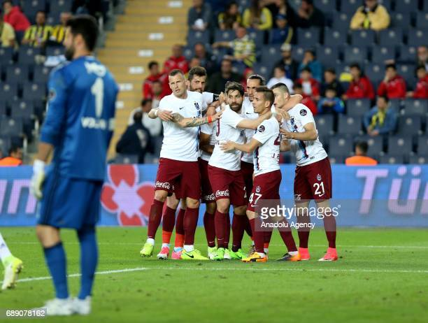 Players of Trabzonspor celebrate after a goal during the Turkish Spor Toto Super Lig soccer match between Fenerbahce and Trabzonspor at Ulker Stadium...