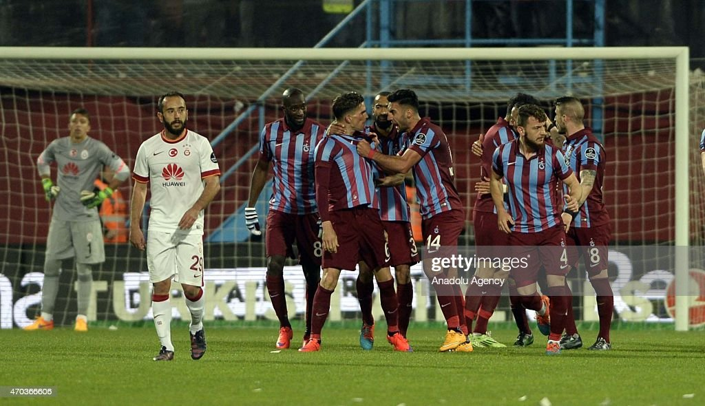 Players of Trabzonspor celebrate their score during the Turkish Spor Toto Super League soccer match between Trabzonspor and Galatasaray at Avni Aker Stadium in Turkey on April 19, 2015.