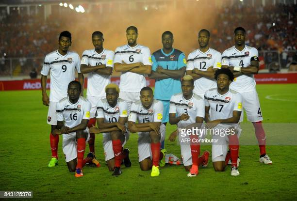 Players of Trinidad and Tobago pose for pictures before the start of their 2018 World Cup football qualifier match against Panama in Panama City on...