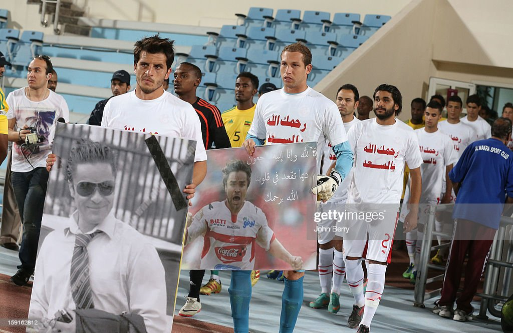 Players of Tunisia pay tribute to their friend, football player Lassaad Ouertani who died days before in a car accident in Tunis, ahead of the international friendly game between Tunisia and Ethiopia at the Al Wakrah Stadium on January 7, 2013 in Doha, Qatar.