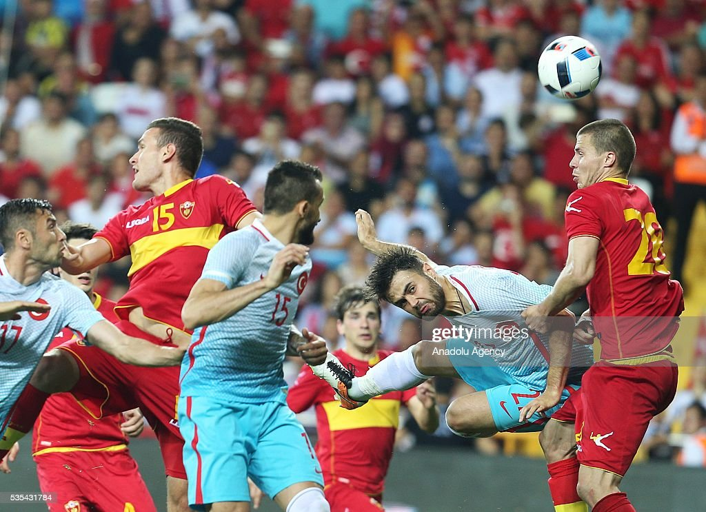 Players of Turkey and Montenegro vie for the ball during the friendly football match between Turkey and Montenegro at Antalya Ataturk Stadium in Antalya, Turkey on May 29, 2016.