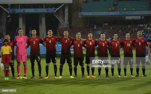 Players of Turkey U17 stand in silence ahead of the FIFA U17 World Cup India 2017 football match between Turkey U17 and New Zealand U17 in Mumbai...