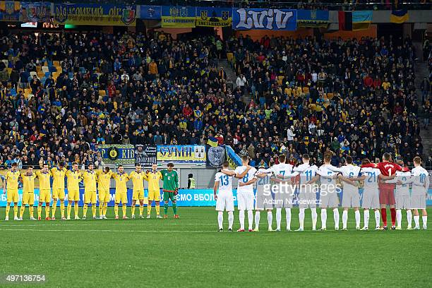 Players of Ukraine and Slovenia during a minute of silence to commemmorate the memory of victims of terrorist attacks in Paris teams before the UEFA...