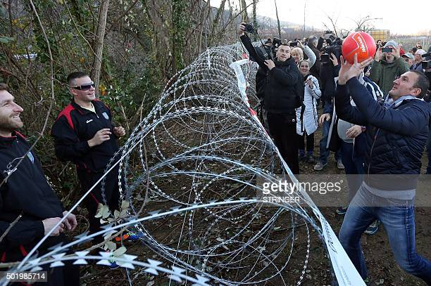 Players of Umag's volleyball team play over a razorwire fence on the Dragonja Kastel border crossing on December 19 2015 during a demonstration by...