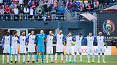 Players of United States stand on the field during a moment of slience for the victims of the shooting in Orlando Florida before a Quarterfinal match...