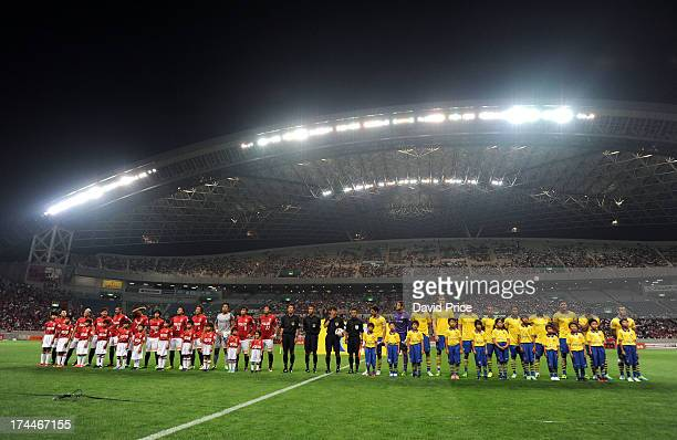 Players of Urawa Red Diamonds and Arsenal line up before the preseason Asian Tour friendly match between Urawa Red Diamonds and Arsenal at Saitama...