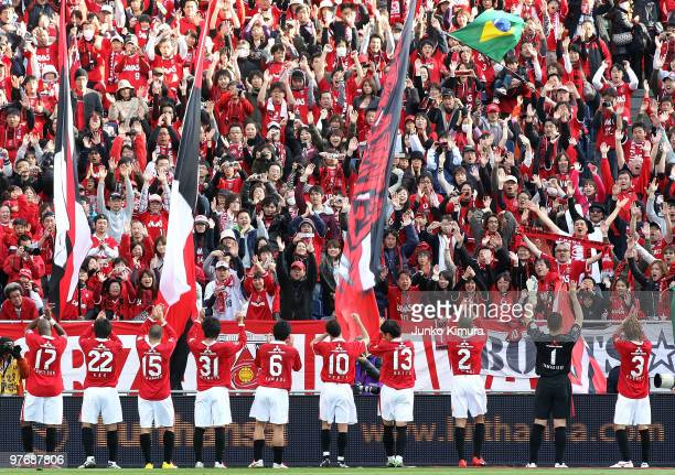 Players of Urawa Red Diamonds greet their fans after winning the JLeague match between Urawa Red Diamonds and Tokyo FC at Saitama Stadium on March 14...