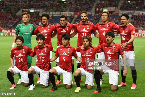 Players of Urawa Red Diamonds line up for the team photos prior to the AFC Champions League Group F match between Urawa Red Diamonds and Western...