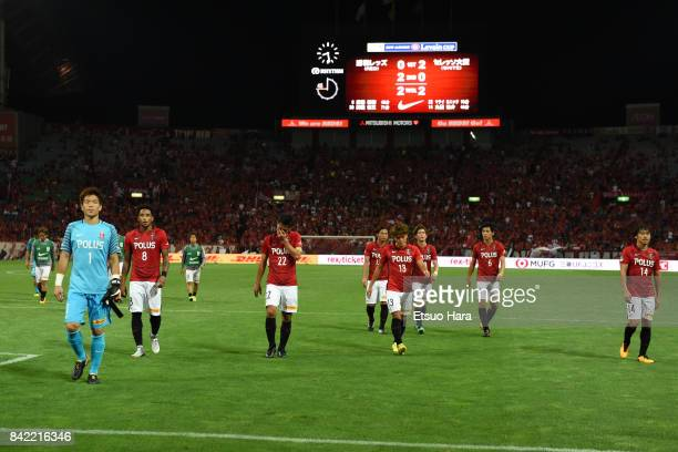 Players of Urawa Red Diamonds show dejection after 22 draw in the JLeague Levain Cup quarter final second leg match between Urawa Red Diamonds ant...