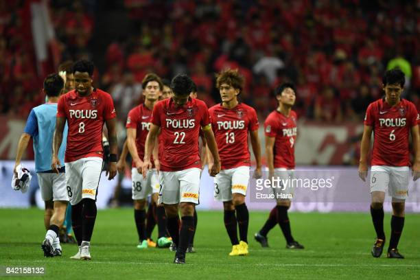 Players of Urawa Red Diamonds show dejection after their 22 draw in the JLeague Levain Cup quarter final second leg match between Urawa Red Diamonds...