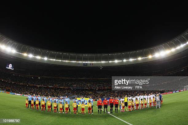 Players of Uruguay and France line up prior to the 2010 FIFA World Cup South Africa Group A match between Uruguay and France at Green Point Stadium...