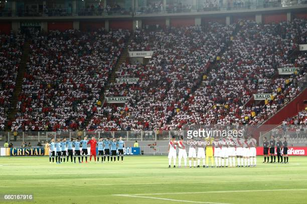 Players of Uruguay and Peru take a moment of silence prior to a match between Peru and Uruguay as part of FIFA 2018 World Cup at Nacional Stadium on...
